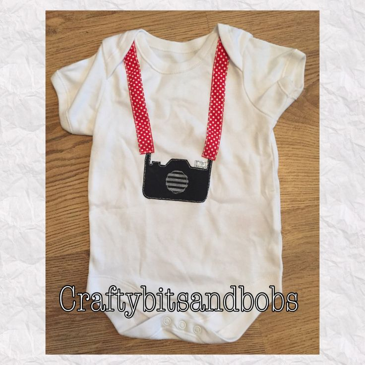 A personal favourite from my Etsy shop https://www.etsy.com/uk/listing/250732198/hand-decorated-bodysuit-camera-onesies