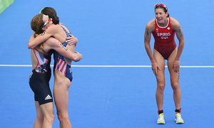 Britain's Vicky Holland (left), who took bronze, embraces the gold medallist…