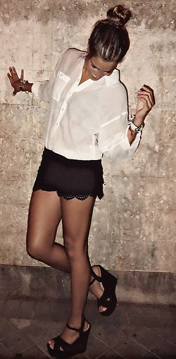 sheer white blouse, black lace shorts, strappy black wedges and high, messy bun. Cuuuute