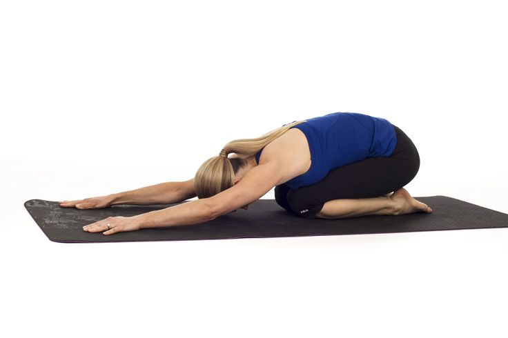 This pose helps to quiet your mind, easing stress and anxiety while gently stretching your back. (It's also good for the nervous system and lymphatic system.)  To get into the pose, sit on your knees while tucking your tailbone towards your heels and stretching your arms in front of you. Rest your forehead on the floor if you are able.