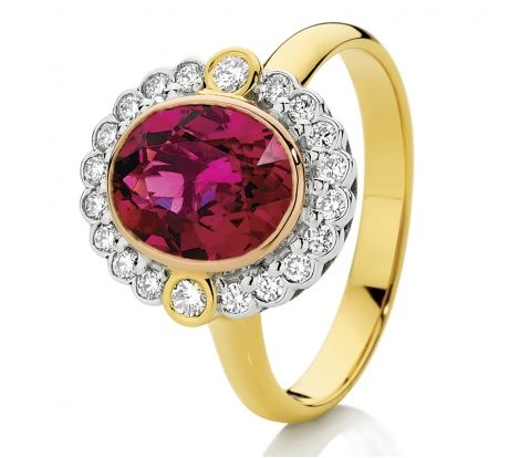 This modern classic features a large, oval natural pink tourmaline stone surrounded by 0.33ct of diamonds TDW in a scalloped cluster. Made to order in 18ct two tone gold, this ring is sure to attract attention. CW1