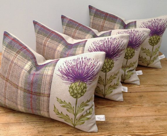 Handmade Scottish Thistle Cushion in a Linen Cotton Blend Blair by Voyage with Pure Highland Wool in Lavender A beautiful cushion handmade in a linen cotton blend featuring Scottish thistle design Blair in Damson by Voyage Decoration, teamed with a gorgeous pure Highland Wool in complementary muted tones of lavender, oatmeal, sage and cream. Measures approx. 38cm x 28cm Backed in a natural linen Envelope closure on the reverse with mother of pearl button detail (new feature) Complete with…