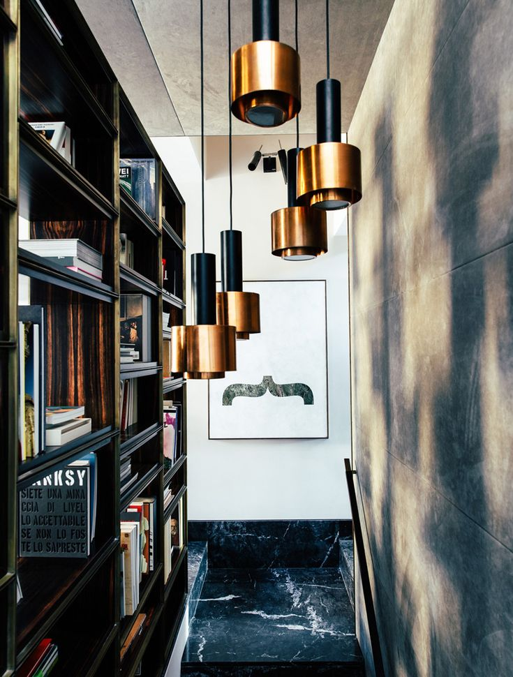 The Home of Italian Architect Massimo Adario has a very warm dark masculine feel. There is certainly a richness of materials displaying a assortment
