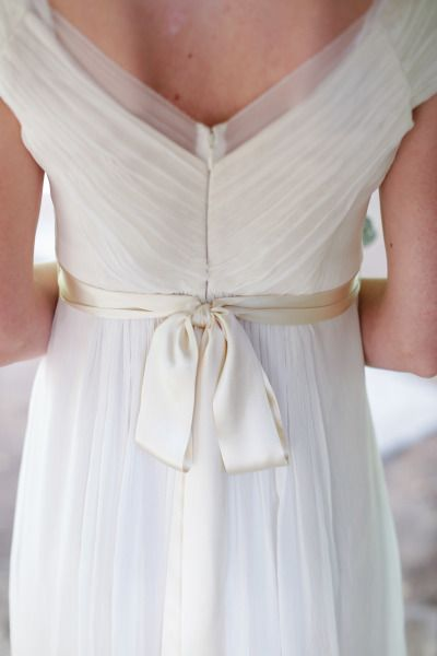 A deep V and a silk bow in the back: http://www.stylemepretty.com/little-black-book-blog/2014/08/26/rustic-hay-ride-wedding-at-rileys-farm/ | Photography: Alders - http://aldersphotography.com/