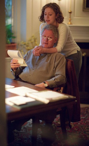 Bill Clinton gets a hug from his daughter Chelsea in the West Wing: | The Last 14 Presidents With Their Children