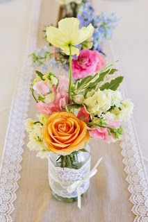 Happy, pastel blooms in jars decorated by the bride, on linen table runner with lace edge.  Event styling and flowers by Green and Bloom.  Photography by Karen Buckle Photography.  Green & Bloom - Flowers, Props, Styling: Real Wedding : Shannon & Alan's Vintage Sunshine Coast Wedding