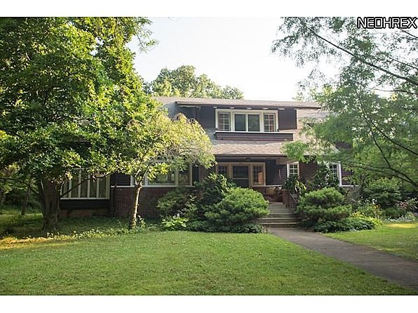 A perfect example of an Arts & Crafts bungalow, this gracious home is located on one of Oberlin's most picturesque and quiet streets. The exterior is a mixture of brick and wood clapboard with lovely wide eaves. A large covered front porch with inlaid tile has an old-fashioned swing to relax on. The front door flanked with beveled glass windows and sidelights leads into a spacious entrance hall with original built-ins. The dining room has leaded glass cabinets, chandelier and built-in…