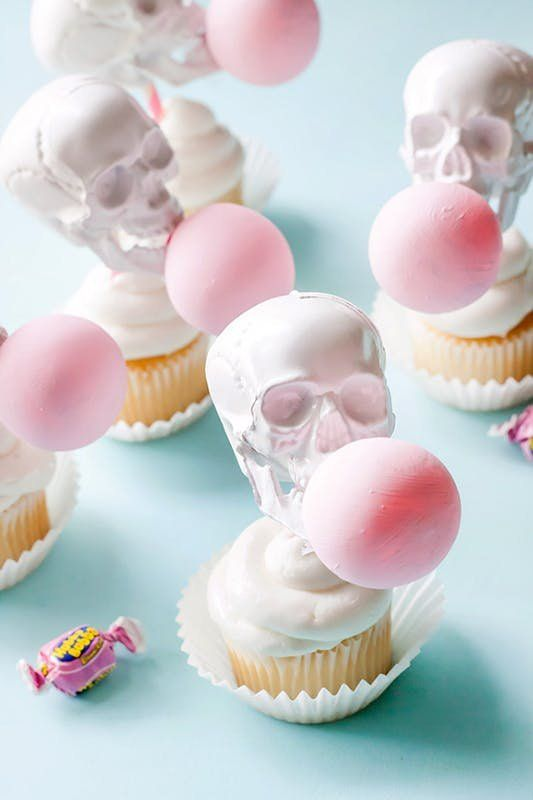 Get a couple giggles out with this DIY bubblegum skull cupcake topper dessert recipe.