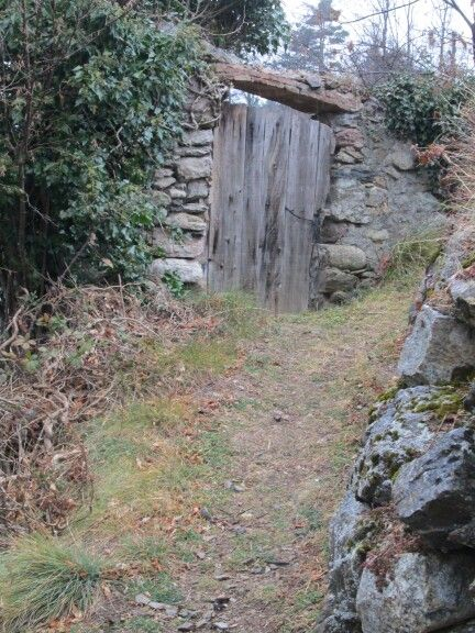 spain, camprodon - rustic wooden gate and stone surround, path