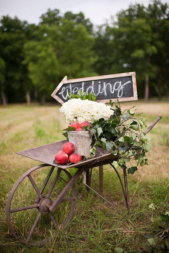 Antique wheelbarrow wedding sign for outdoor wedding / http://www.deerpearlflowers.com/wagon-wheelbarrow-country-wedding-ideas/