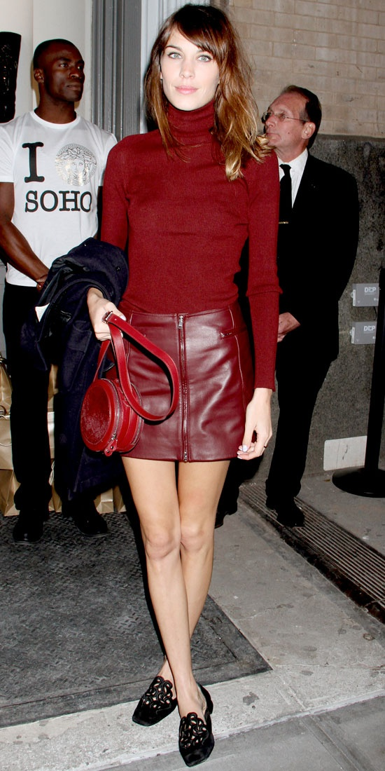 Chung hit Versace's Soho bash in a leather skirt and slim turtleneck from Versus that she styled with a round tote and lasercut flats.