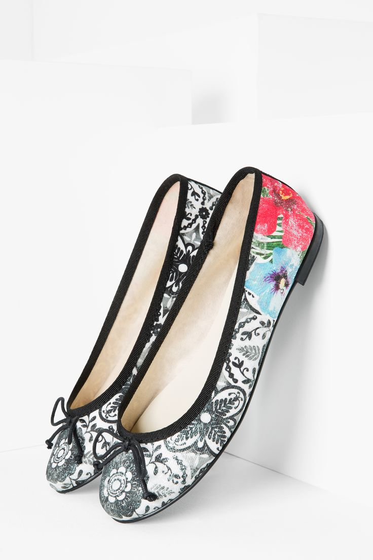 Desigual's Missia Alhambra shoes have a subtle but classy black and white print, punctuated with bright florals.