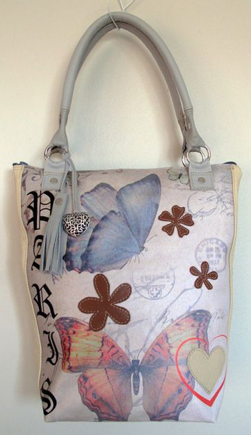 Leather and butterflies on canvas