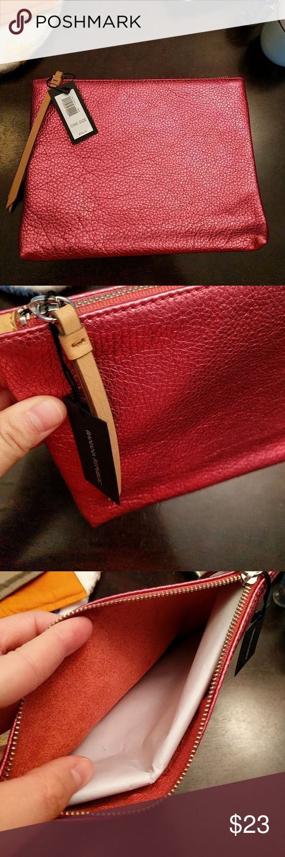 Banana Republic pouch (pink or orange) NWT pink shimmer or shimmer orange BR pouch.  Perfect thing to hold your cosmetics and great organizer to keep your small items together in a big tote bag. Faux leather zipper accent. Banana Republic Bags Cosmetic Bags & Cases