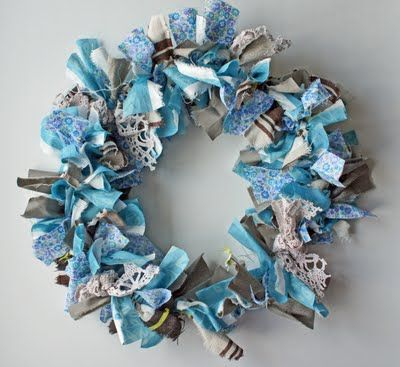 DIY fabric scrap wreath... cheap & easy- use coat hanger as mold, and scrap fabrics as material. My friend made an adorable one out of her kids old clothes.