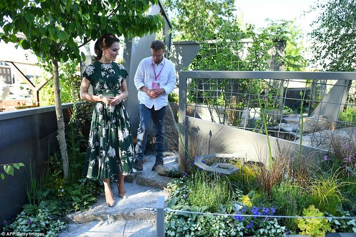 Kate was in high spirits as she enjoyed a summer's afternoon at the iconic flower show. She showcased her trim figure in a new green and white floral print dress