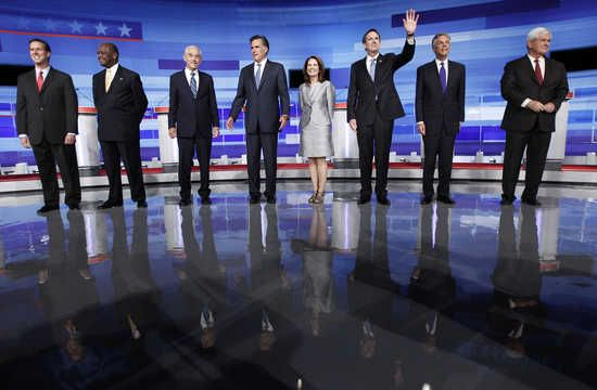 U.S. Republican presidential candidates gather before the start of their debate in Ames, Iowa August 11, 2011. They are (from L to R) Rick Santorum, Herman Cain, Ron Paul, Mitt Romney, Michele Bachmann, Tim Pawlenty, Jon Huntsman and Newt Gingrich. REUTER