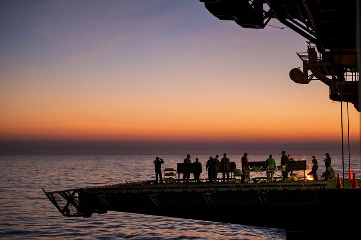 BBQ Deluxe. Sailors and Marines barbecue on a starboard flight-deck elevator during a picnic aboard USS America (LHA-6). Pacific Ocean Feb. 1 2018. The amphibious assault ship is returning from a seven-month deployment. USN photo.