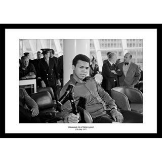 "The perfect gift for sports fans! On the 11th July 1972, the ""Greatest of all Time"" Muhammed Ali landed at Dublin airport to be presented with a shillelagh! This press photo brilliantly captures that moment as Ali held a press conference to a fascinated press corp."