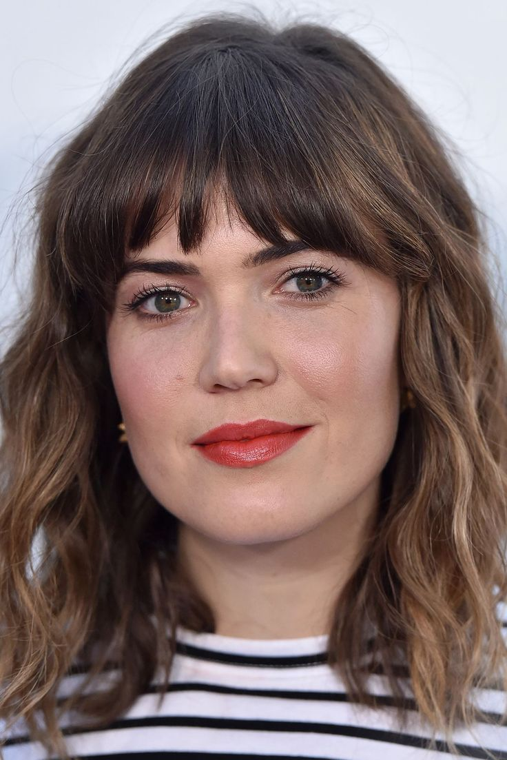 We Had No Idea Mandy Moore's Beauty Evolution Was THIS Extreme #refinery29  http://www.refinery29.com/2016/12/133495/mandy-moore-best-hair-makeup-looks#slide-25  2016Mod bangs and glossy, poppy-red lips? Sign us up....