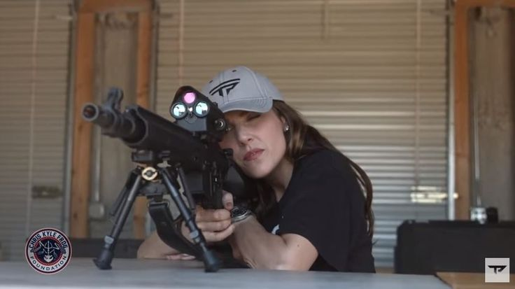 """""""American Wife"""" Taya Kyle, widow of Chris Kyle, did her husband proud by winning a shooting competition Saturday using a special target-assisted firearm collection against a world-class sniper."""