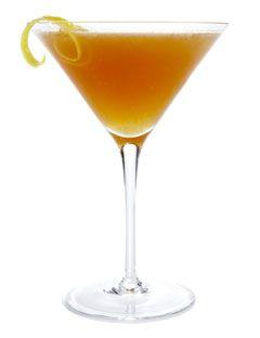 Esquire  2 1/4 ounces bourbon  3/4 ounce Grand Marnier  1 1/2 teaspoons orange juice  1 teaspoon lemon juice  1 or 2 dashes Angostura bitters