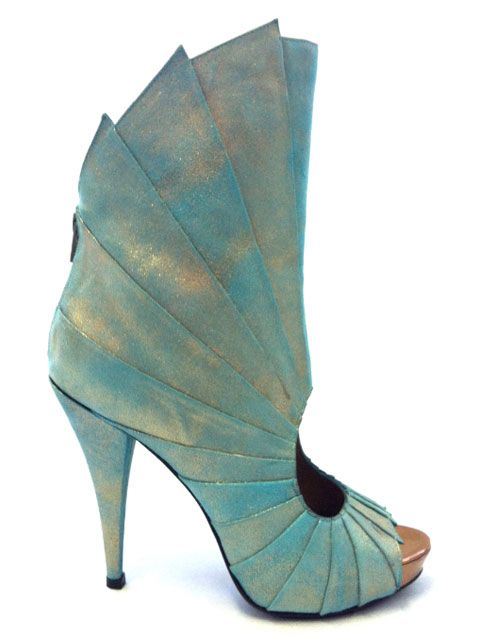 The feminine cuts of the peep toe and upon foot, contrast the armor-like shield around the ankle. The colors and the fan-like details seem to romance the idea of a future underwater world - designed by Mattijs van Bergen for United Nude, SS 2012