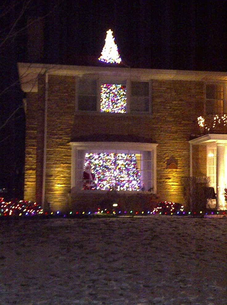House with the tree through it in Sauganash. Christmas