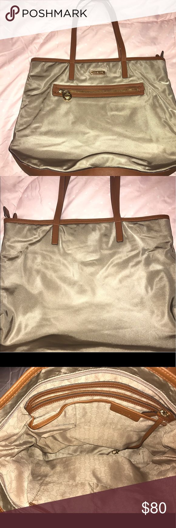 Michael kors purse Fair condition, inside looks good, outside looks good----make me an offer Michael Kors Bags