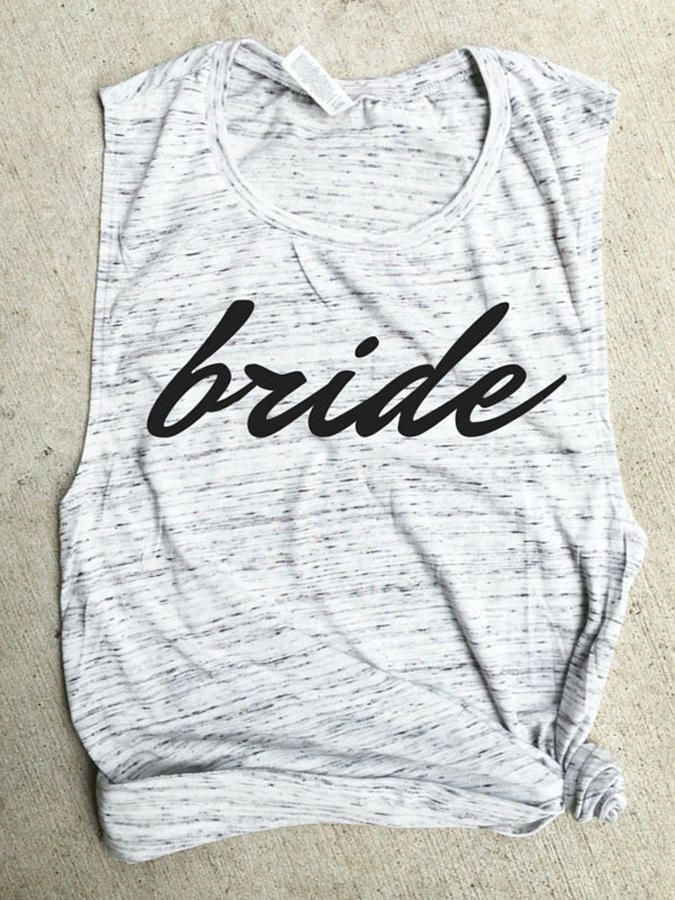 "Keep it clean and simple with a statement ""Bride"" muscle shirt to make a chic appearance at your bachelorette party."