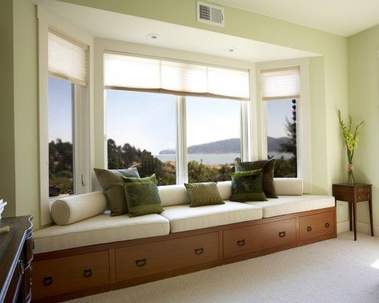 Comely modern bay window with seat with contemporary living room with elegant green cushions color also wooden drawers under the seats also modern curtains design also small chest of drawers with white rug