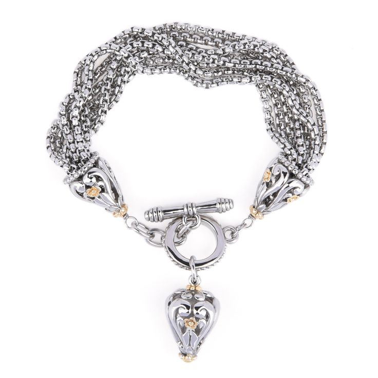 An elegant piece of bracelet, dangling with an intricately crafted charm, lots of details going on . Not the usual charm bracelet you found on market.
