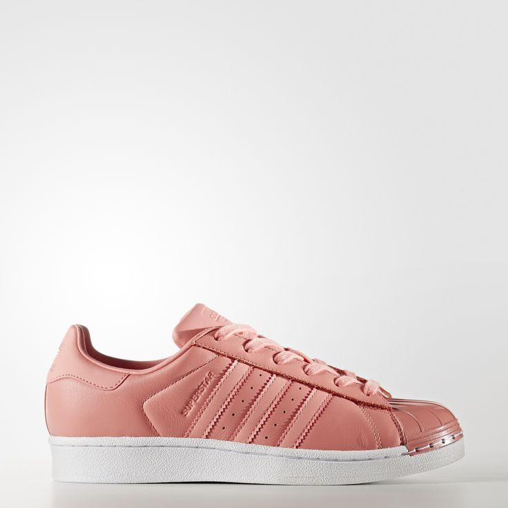 Basketball's first all-leather low top continues to ride in high style.  These women's shoes add some glam to the iconic adidas Superstar design  with a metal ...