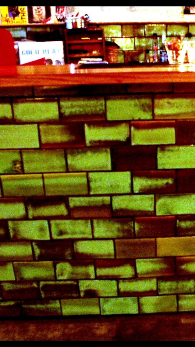 Green and metallic tiles. Made by Fox and Bean ceramics company in Melbourne, Victoria. In situ at Gin Lane bar in Belgrave #greentiles#foxandbean#