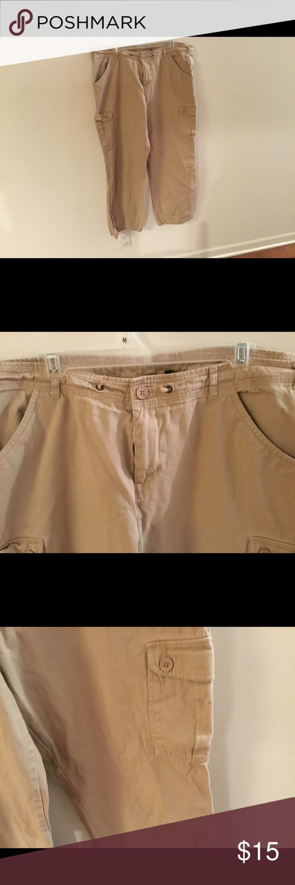 Cargo pants Metro style khaki/tan cargo pants size 18W. Legs can by cinched in with the draw string. Inseam approximately 29 inches. Pants Straight Leg