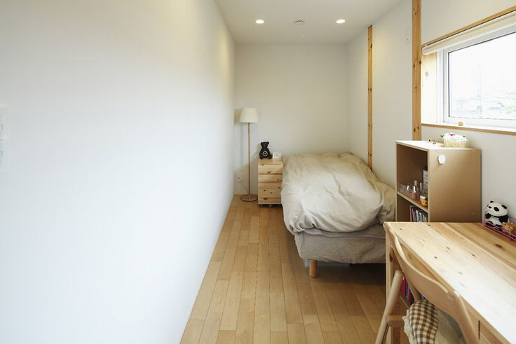 A room for guest, very warm and clean. on the wall still can hang things or even have a built-in closet.