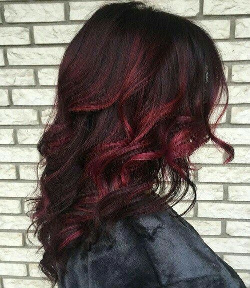 Dark Red Highlights on Wavy Shoulder Length Hair