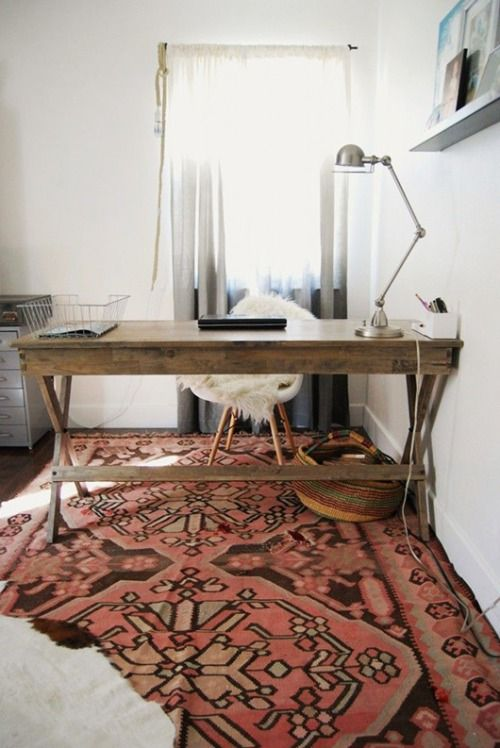 Gorgeous bohemian home office / workspace. Love the vintage / rustic desk, the white walls and carpet.