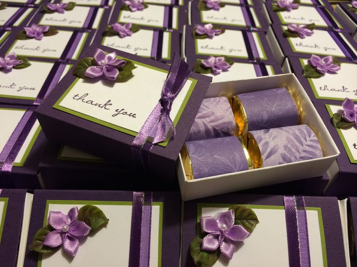 Wedding Favors using Stampin' Up's matchbox die, elegant eggplant & whisper white card stock. Wrap 4 Hershey's Nuggets in coordinating designer paper & either stamp or decorate sliding topper with tiny flowers.