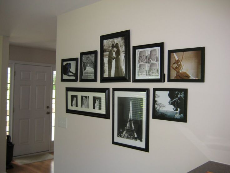 black and white photo wall arrangements | traded out old for new as our family grew & changed. this is more ...