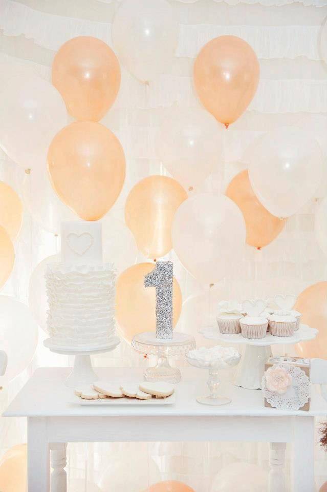top dessert table of the week balloon backdrop peach and white dessert table