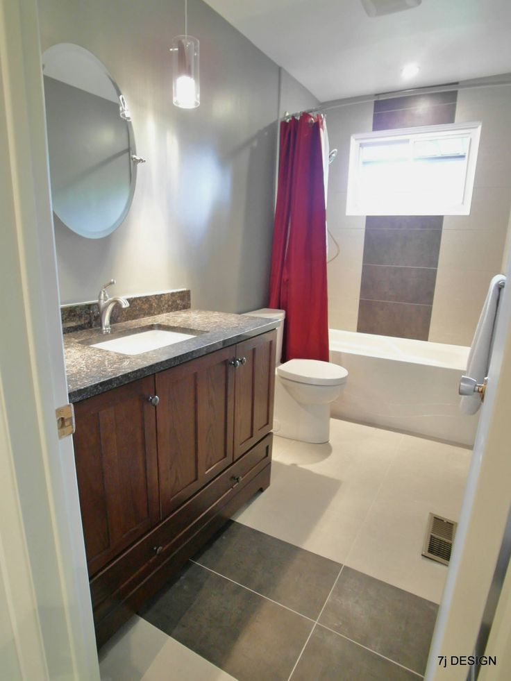 This bathroom was gutted and redone by 7J Design.  The mix of modern and classic design also includes a touch of red.