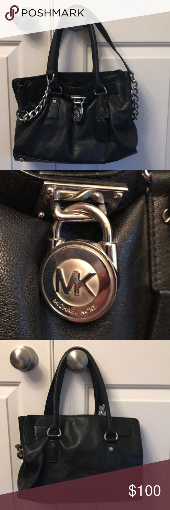 Michael Kors Small Black Hamilton Tote Gently used authentic MK Hamilton Tote - it is the smaller size, but fits a lot! Black leather with silver chain and MK logo on the front. The outside is in amazing condition! The back handle shows some wear, and the inside pockets have some wear as well. So much life left in it! KORS Michael Kors Bags Totes