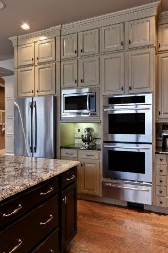 White and black cabinets. Wood tone floors though we'd like them a little darker.