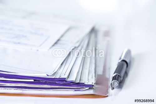 Stack of bills and pen