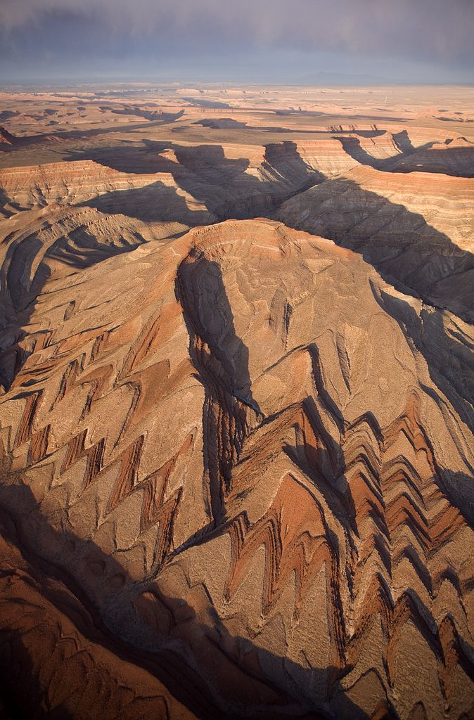 Raplee Ridge, part of the Monument Upwarp in southeastern Utah, is a long, narrow, folded anticline that formed about 70 million to 50 million years ago.