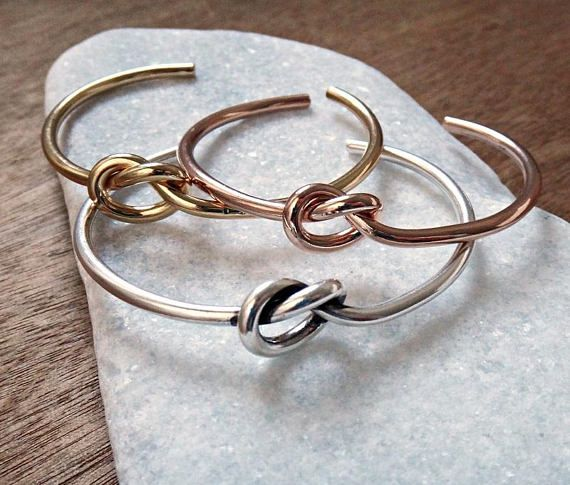 A bangle bracelet is always a good idea. This beautiful knot cuff is made of gold plated (24 K) brass and silver plated brass and available in gold, silver and rose gold. Open band that makes it easy to slip on and off. Wear it solo or layered with similar styles. Colors may vary slightly