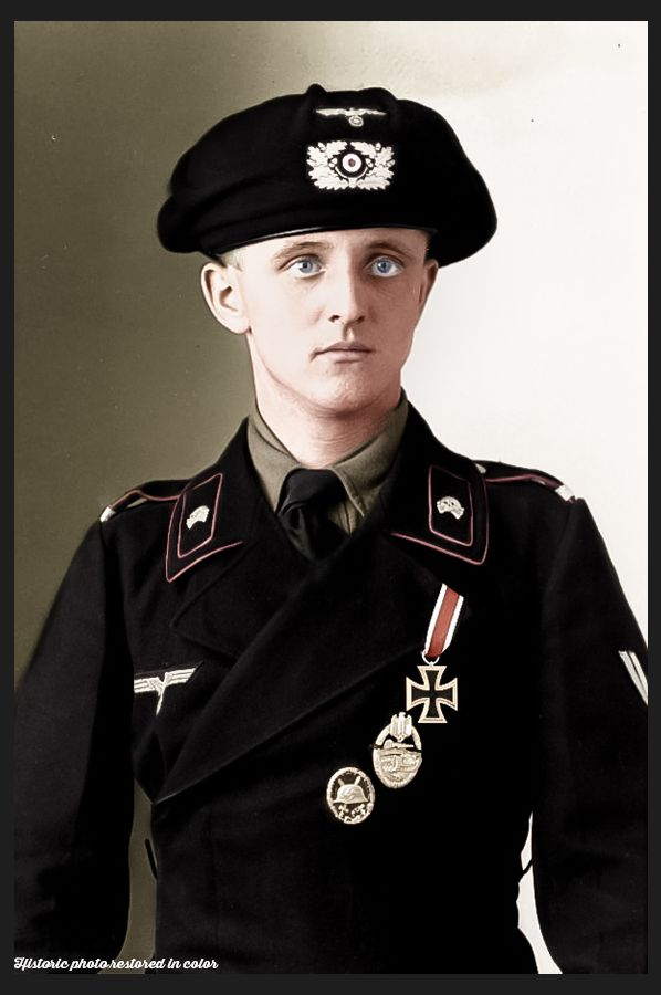 This soldier of the Aufklärungs-Abteilung wears the distinctive black uniform of all Panzer and Armoured Car crews during the campaigns in Czechoslovakia, Poland and France.  Black was used so that oil and other stains associated with working with armoured vehicles would not show up. Black was also the traditional colour of Frederic the Great's Prussian Hussars, meaning this uniform was following a Cavalry tradition dating back to the mid 18th Century.  On his head he wears the Panzer beret…