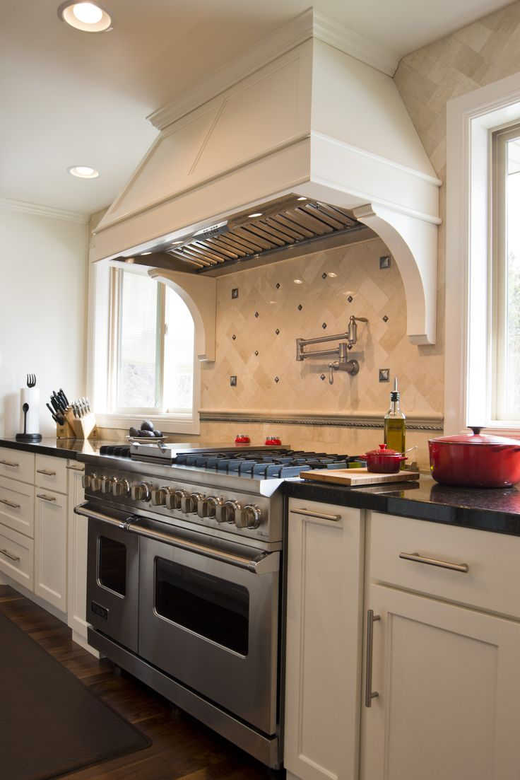 Beautiful white custom cabinetry. Anvil Cabinets - www.anvilcompanies.com