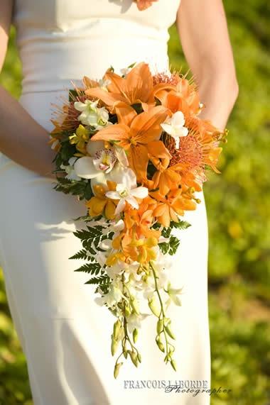 Flower Bouquet orange lilies cascade style deland fl wedding flowers 32724/ orange city fl wedding flowers/  volusia county wedding flowers/ www.callaraesfloralevents.com/